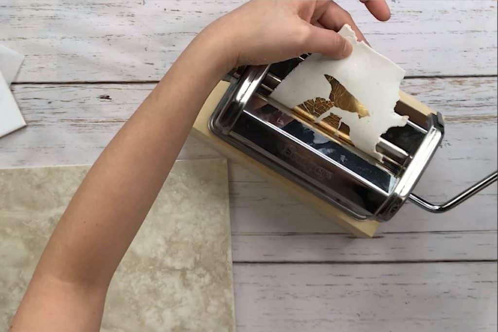 Applying gold leaf on polymer clay